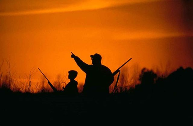 800px-Silhouette_of_father_and_son_hunting_in_the_sunsetHester Eugene, U.S. Fish and Wildlife Service